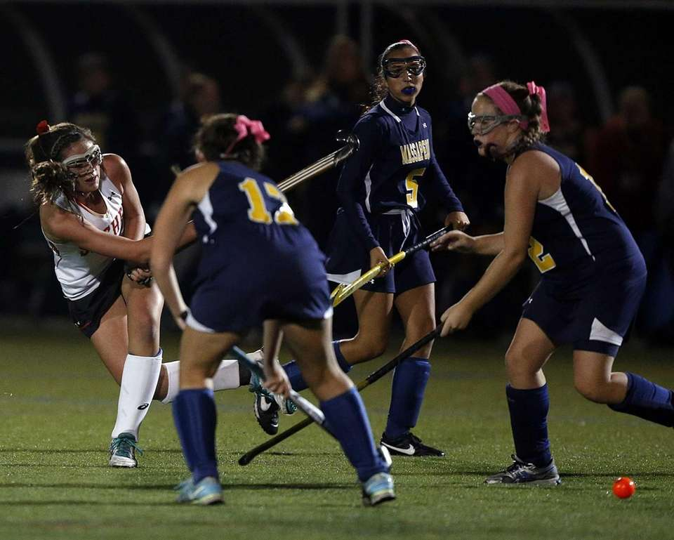 Sachem's Katie Trombetta shoots on goal between three