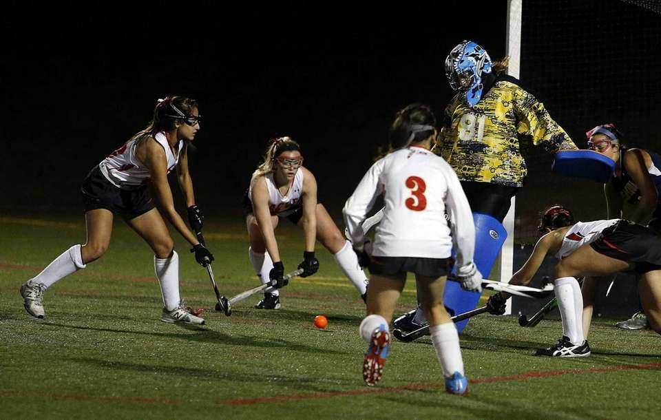 Massapequa goalie Cassidy O'Brien kicks away a shot