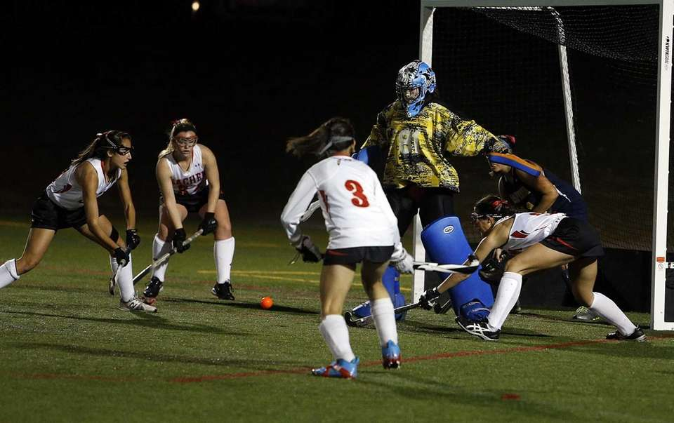 Four Sachem East players attack the ball in