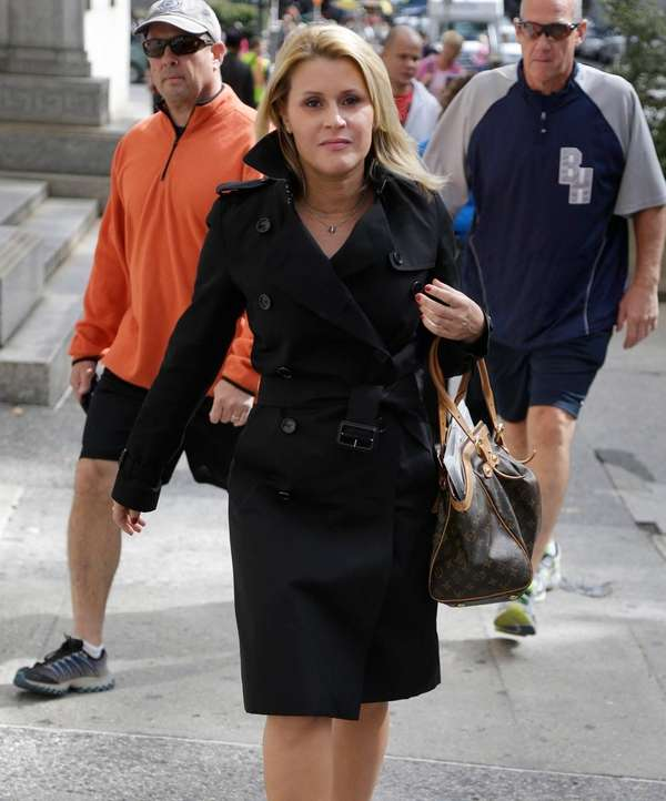 Genevieve Sabourin leaves court in New York. (Oct.