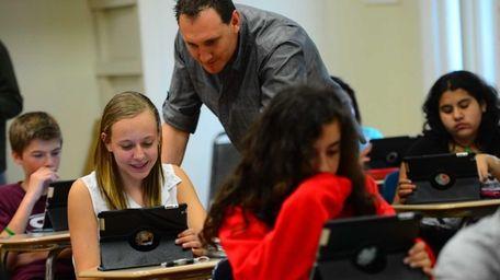 13-year-old Jaycee Jones uses an iPad during Social