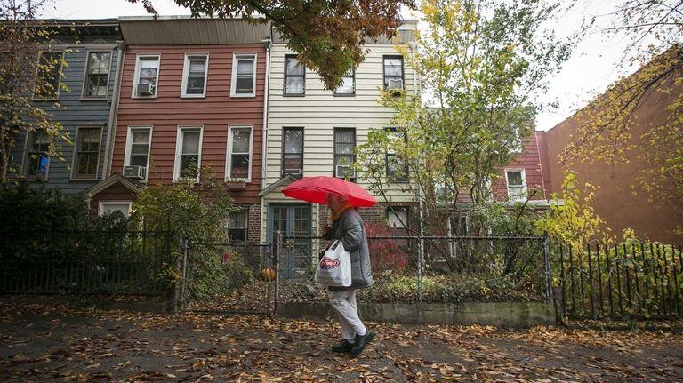 People walk past Bill de Blasio's home in
