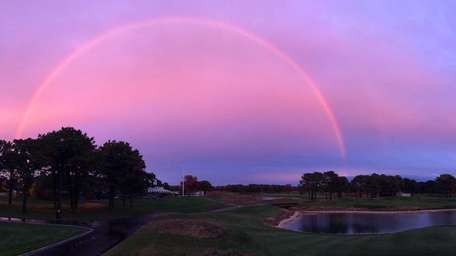 A rainbow, seen from Colonial Springs Golf Club