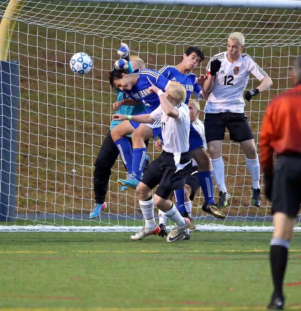 John Glenn's Steven Jannace heads the ball on