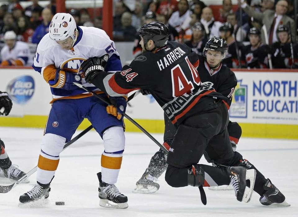 Carolina Hurricanes' Jay Harrison (44) defends against Frans