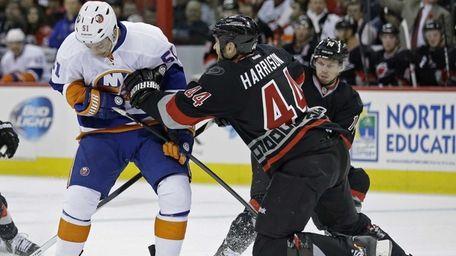 Carolina Hurricanes' Jay Harrison (44) defends against Frans