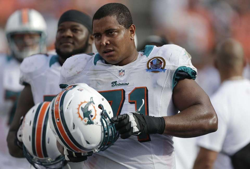 Miami Dolphins tackle Jonathan Martin watches from the
