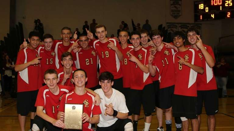Sachem East poses with the championship plaque after