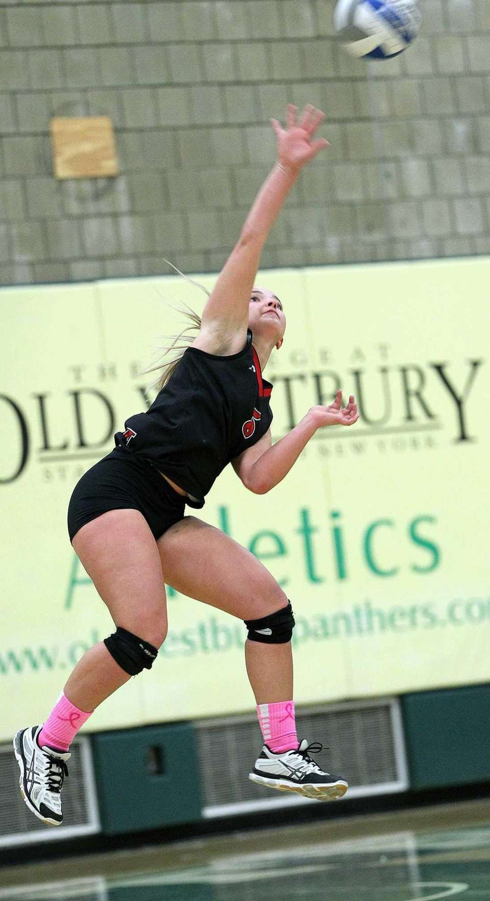Long Beach's Dakota O'Neill fires up a serve