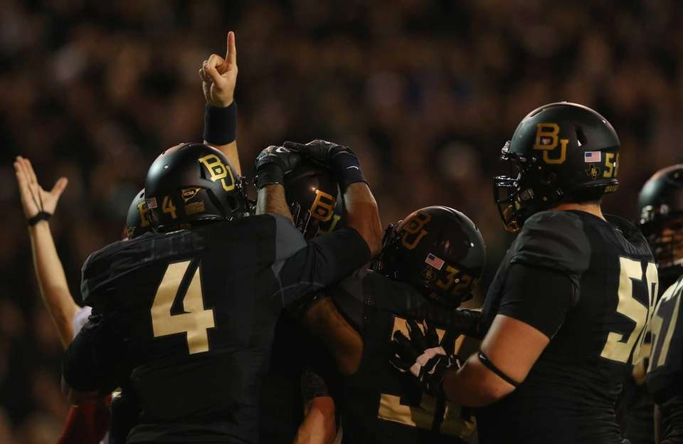 The Baylor Bears celebrate a touchdown by Bryce