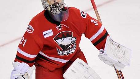 Charlotte Checkers goalie Rick DiPietro stands in net.