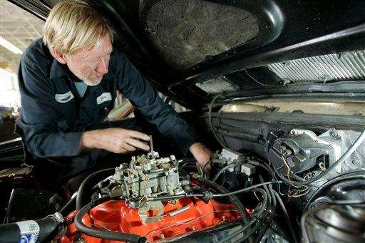 Auto mechanic Jack McEachern works on a customer's
