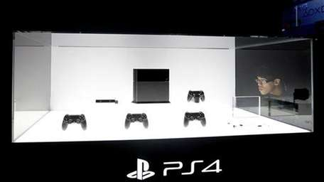 A show attendee looks at the new PlayStation