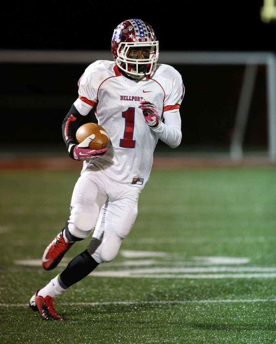 Bellport's Andrew Trent catches a pass with seven
