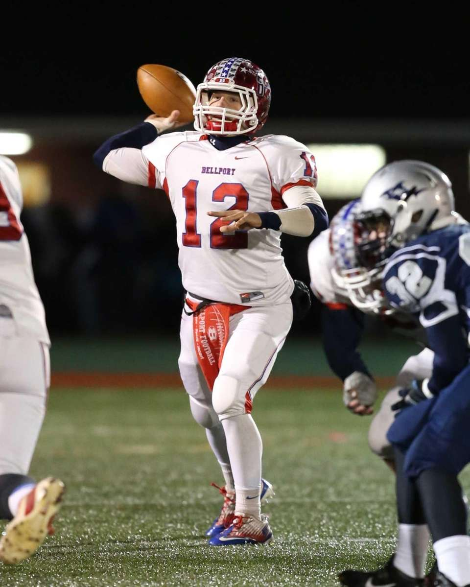 Bellport quarterback Nick Fountis drops back with seconds