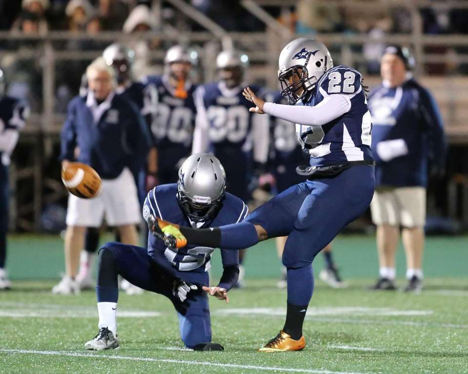 Eastport-South Manor placekicker Nijay Brown attempts a field