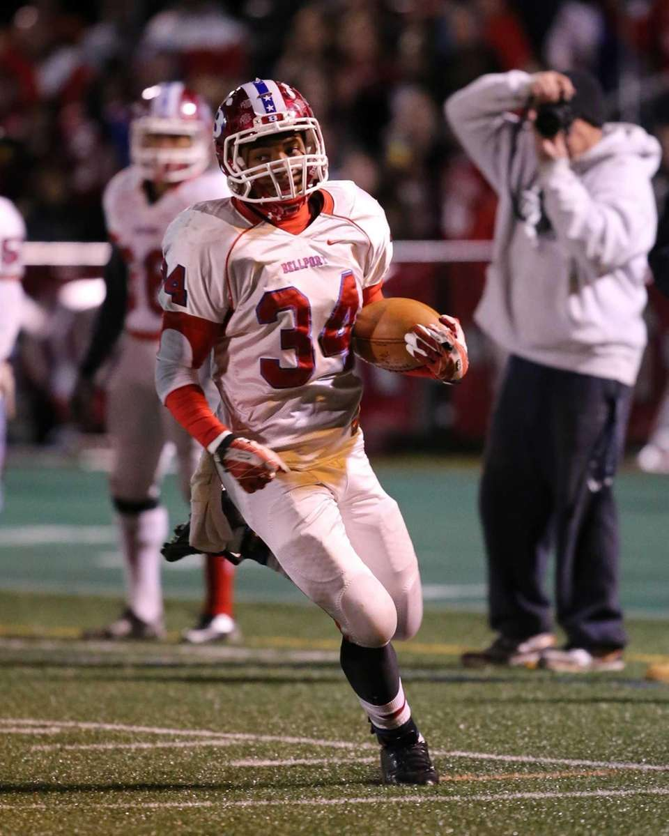 Bellport running back Jabari M'Bhaso runs for a