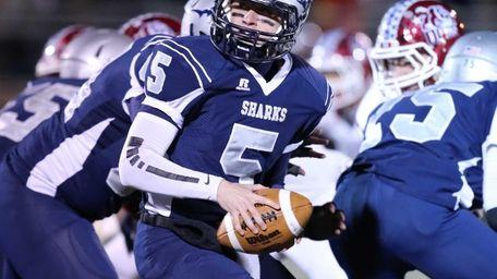 Eastport-South Manor quarterback Austin Macchi drops back in