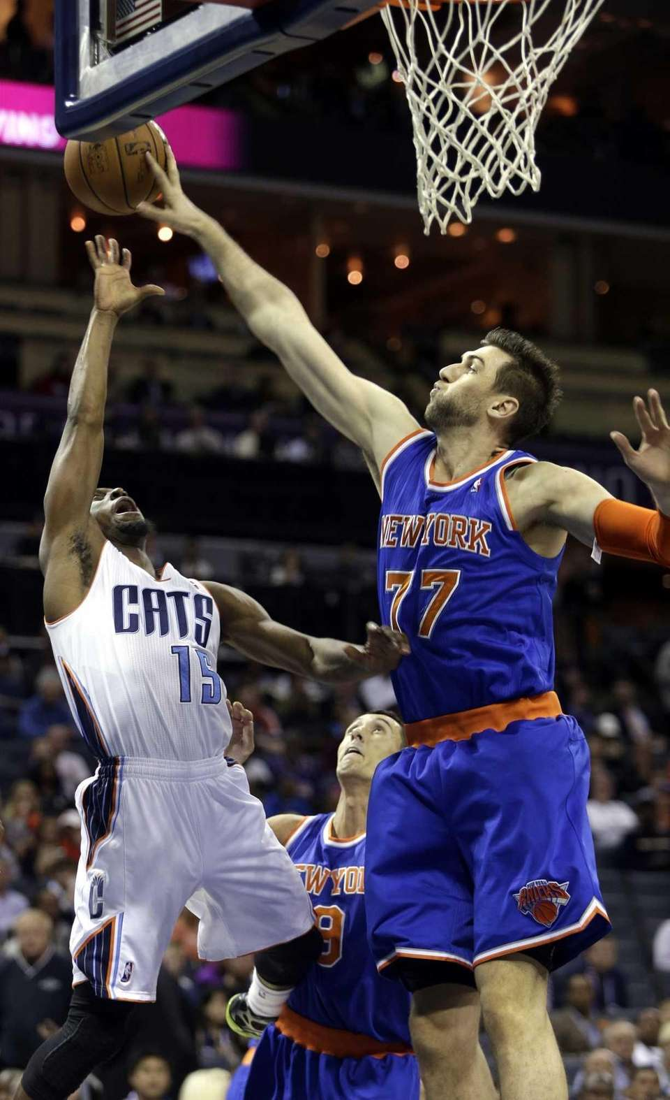 Knicks forward Andrea Bargnani, right, blocks the shot