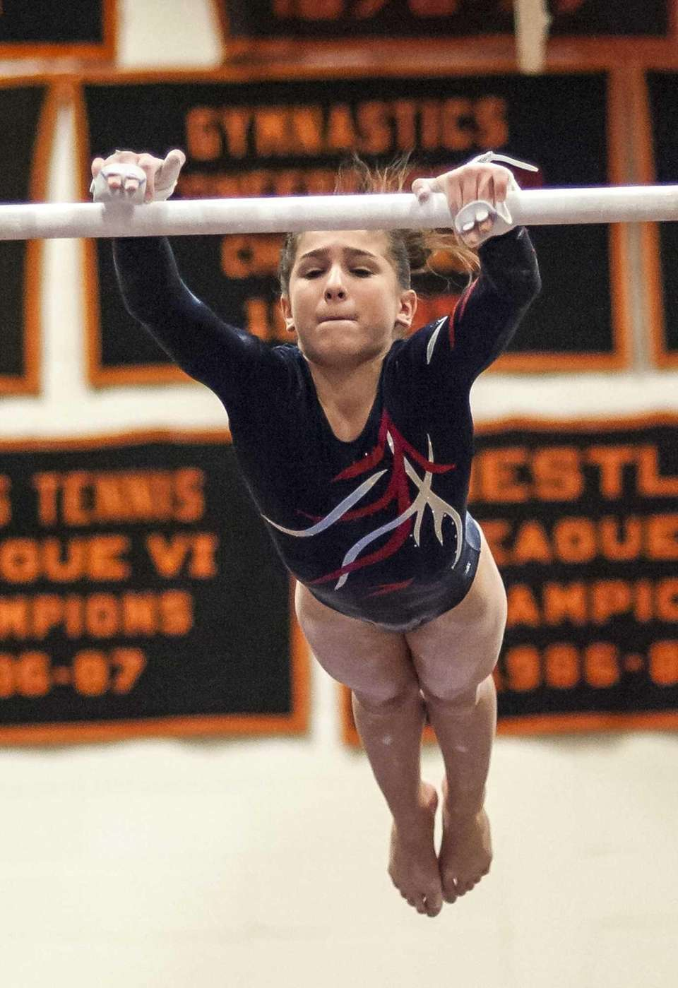 Miller Place's Jordan Ceccarini competes on the bars.
