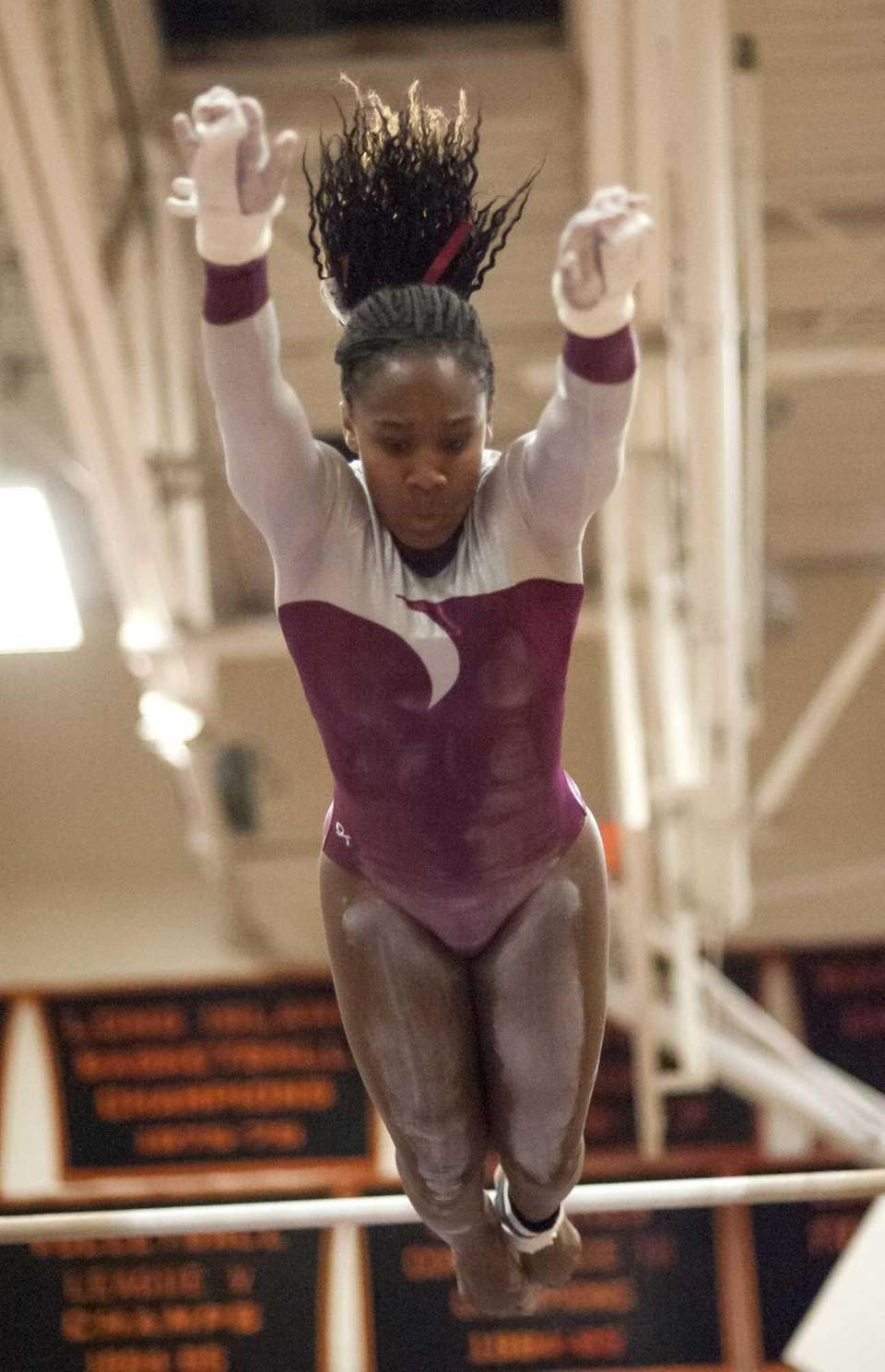 Bay Shore's Hayden Davidson competes on the bars.