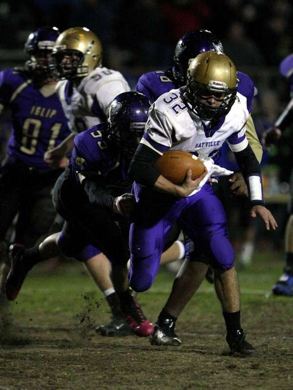 Matthew Selts of Sayville gains some yardage during