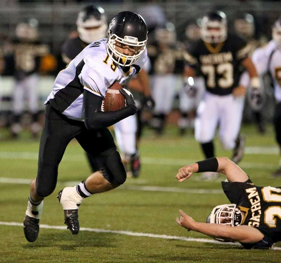 Northport WR Ken Radigan breaks the tackle and