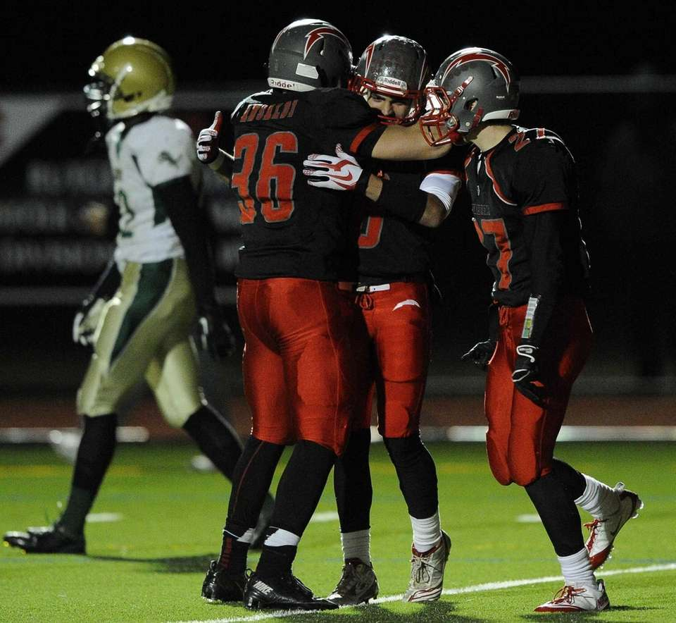 Connetquot's Tyler Nason, facing, is congratulated by Mike