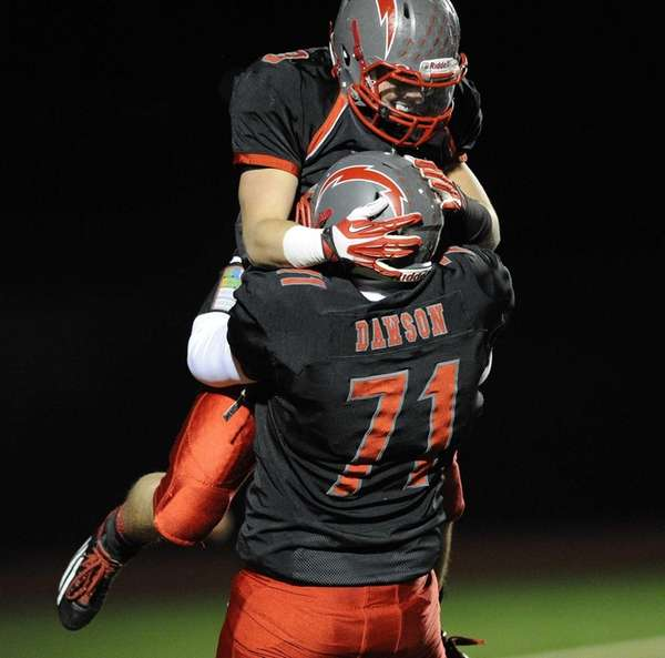 Connetquot's quarterback Michael Grimaldi, top, celebrates with Robert