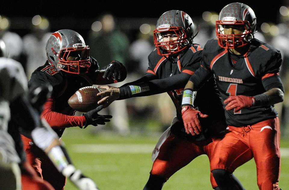 Connetquot quarterback Ricky Hahn hands the football off