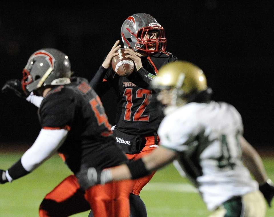 Connetquot quarterback Ricky Hahn looks for an open