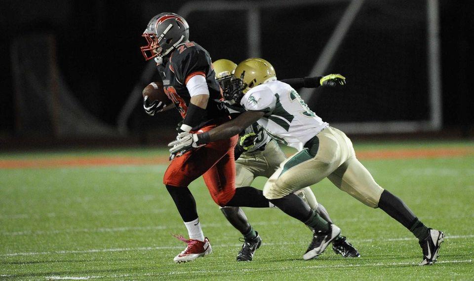 Connetquot's Bryan Ramirez runs the football against Longwood