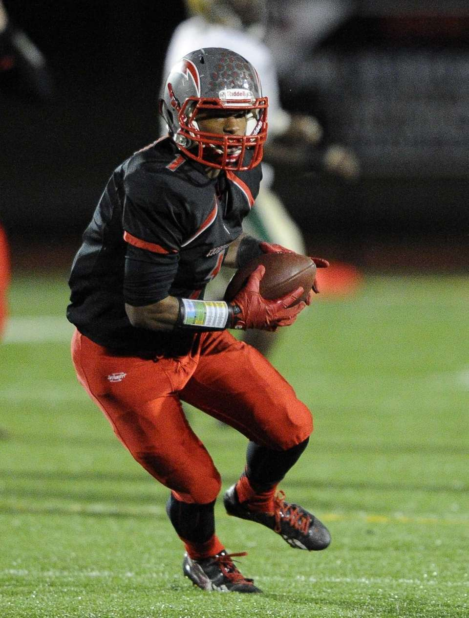 Connetquot's Carlton Woodie runs the football against Longwood
