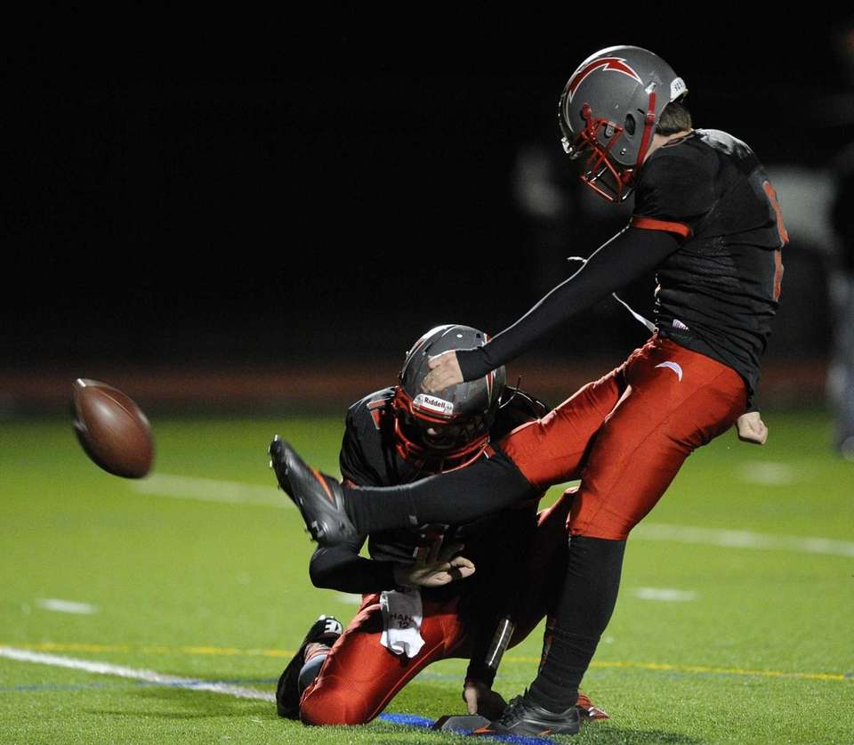 Connetquot's Peter McKasty kicks for an extra point