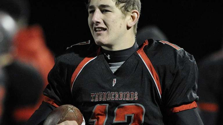 Connetquot quarterback Ricky Hahn looks on from the