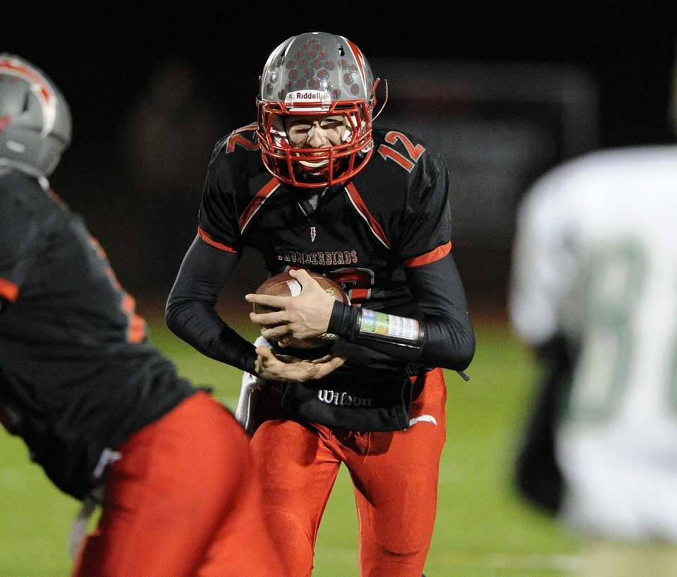Connetquot quarterback Ricky Hahn runs the football against