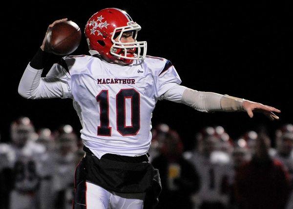 MacArthur quarterback Jimmy Kelleher looks for an open