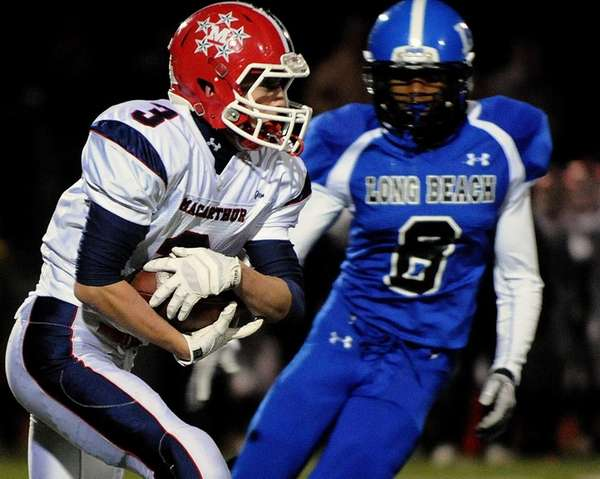 MacArthur's Tom McAndrew rushes for a gain during
