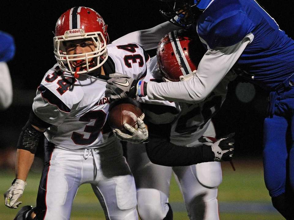 MacArthur running back Carmine Criscione rushes for a