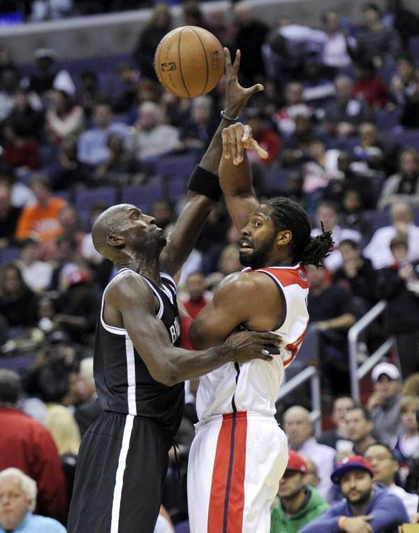 Washington Wizards forward Nene, right, passes the ball