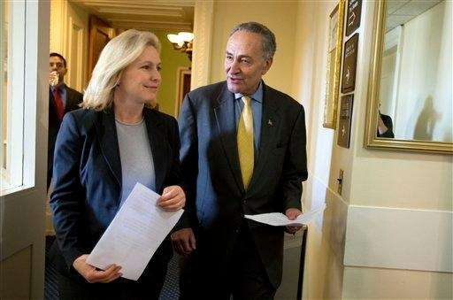 Sens. Kirsten Gillibrand and Charles Schumer (D-N.Y.) enter