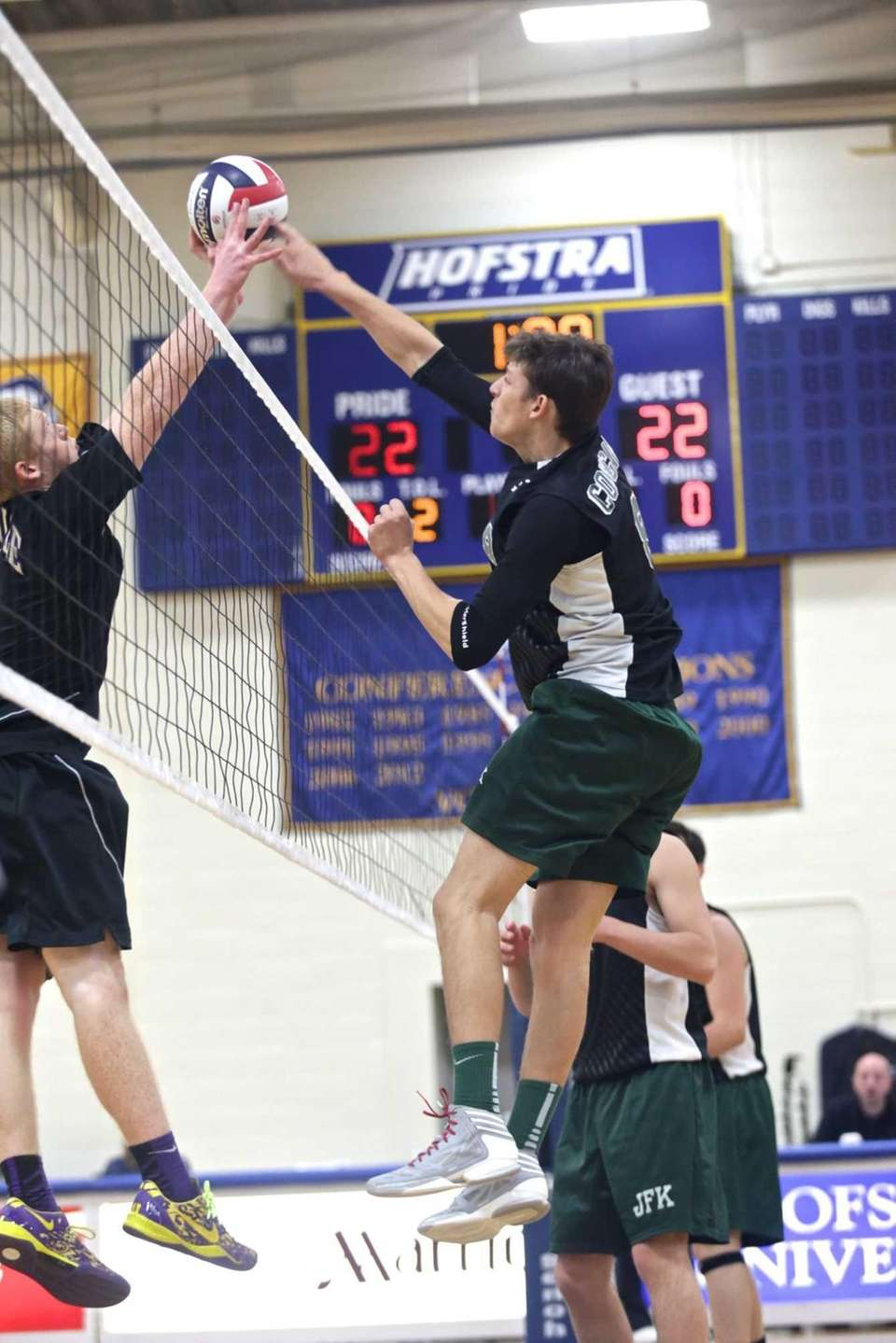Bellmore JFK's Justin Feigles scores a point against