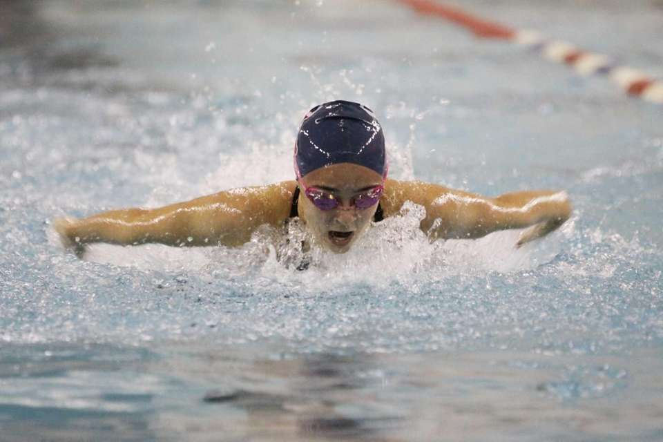 Smithtown's Jackie Dominger competes in the 100-yard butterfly