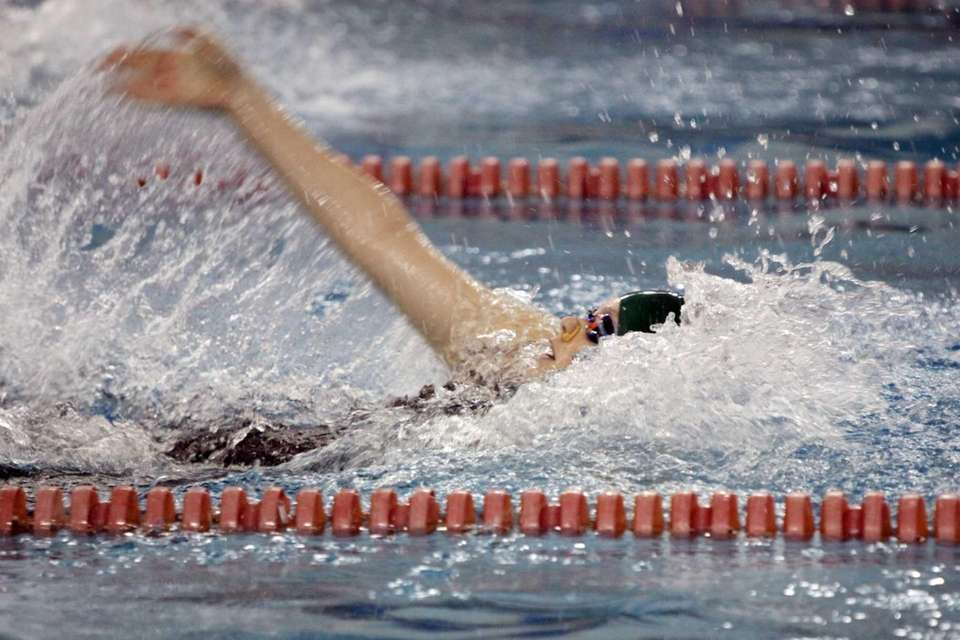 Ward Melville's Casey Gavigan competes in 100-yard backstroke