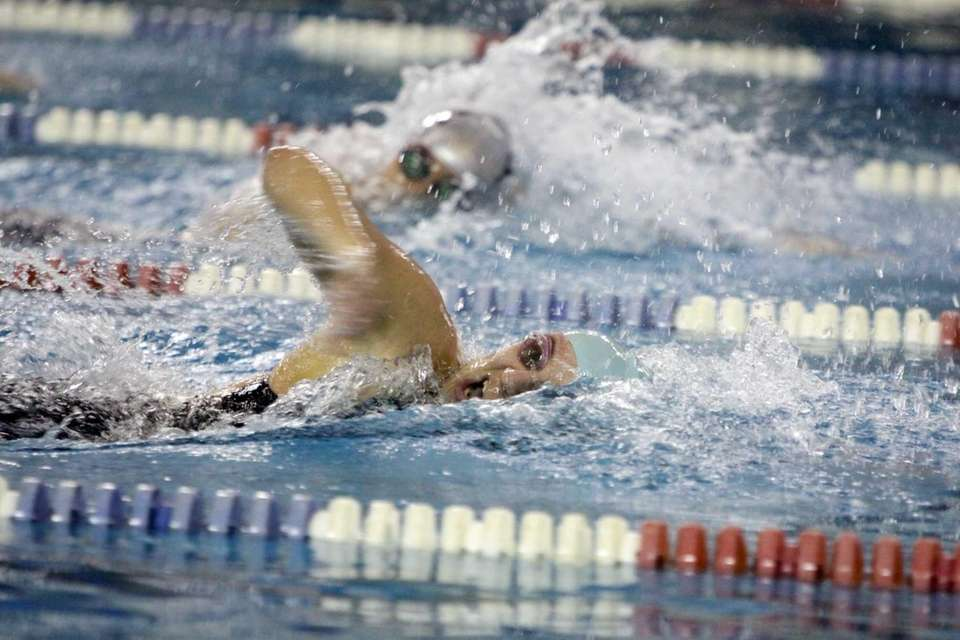 Babylon's Julianne Koch competes in the 100-yard freestyle