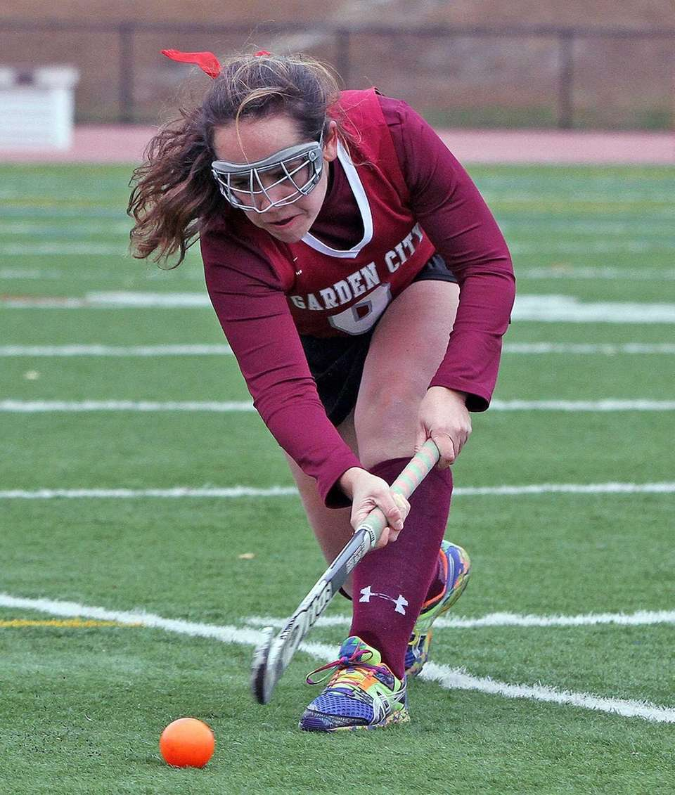 Garden City's Jacquelyn Marino clears during the New