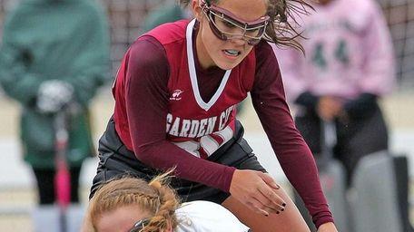 Garden City's Isabel McKeown tries to jump over