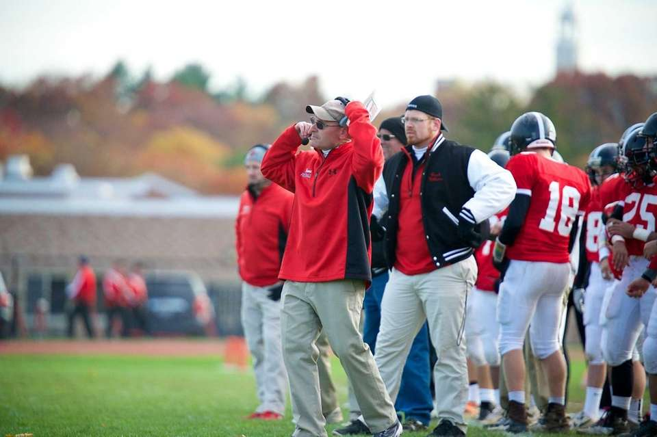 Syosset head coach Paul Rorke looks on during