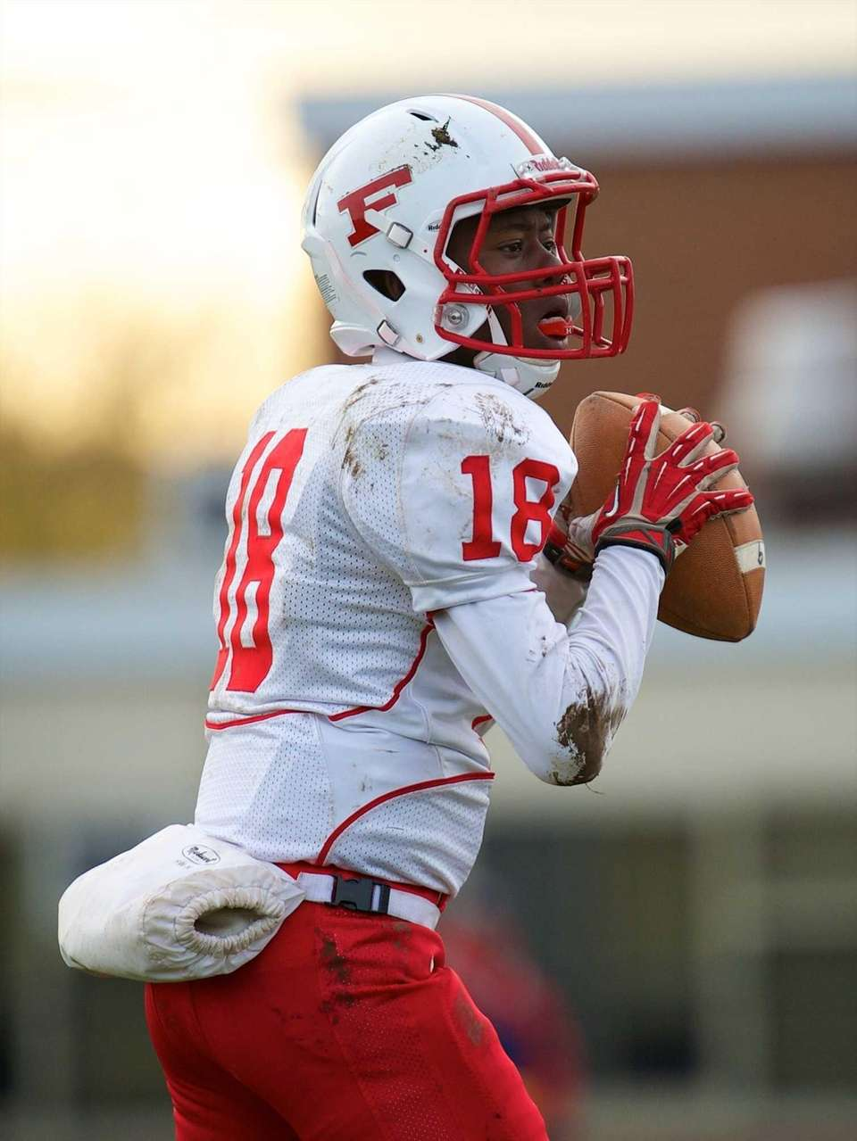 Freeport quarterback Rasheed Tucker looks to pass during