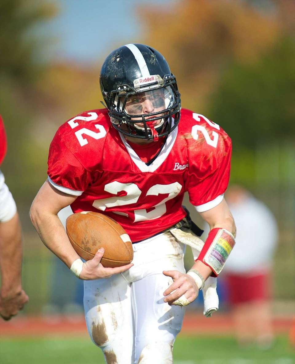 Syosset running back Anthony Carchietta runs the ball
